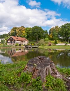 Big Family House In Front Of The Lake In The Forest Stock Photography