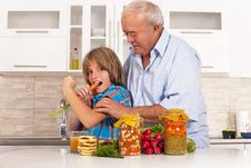 Free Grandson And Grandfather Eat Healthy Foods Royalty Free Stock Photography - 36427547