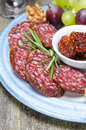 Free Snacks On A Plate - Sausage, Sun-dried Tomatoes, Nuts, Fruits Royalty Free Stock Photo - 36435765