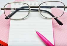 Free Pink Pen Notebook And Glasses Royalty Free Stock Photo - 36439715