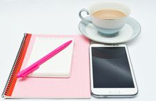 Pen Notebook And Glasses And Cup Of Chocolate Drink Stock Photo