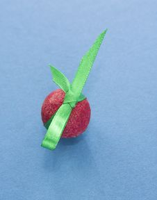 Free Red Praline With Green Ribbon On Blue Background Stock Photos - 36441643