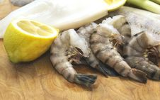 Free Raw Seafood,cuttlefish, Fish And Scampi With Lemon On Board Royalty Free Stock Photo - 36441645