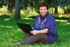 Free Woman With Laptop On Green Lawn. Stock Photography - 36478962