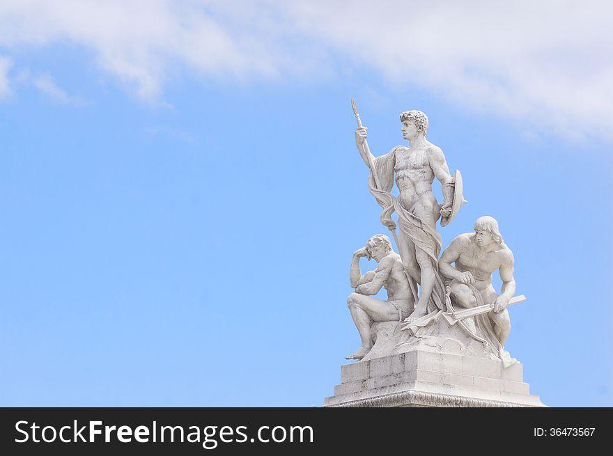 Three men statue at National Monument of Victor Emmanuel II Rome piazza Venezia