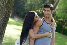 Happy Smiling Couple Laying On Green Grass Stock Photography