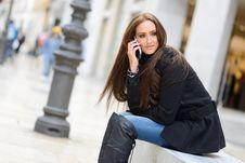 Free Beautiful Young Woman In Urban Background Talking On Phone Royalty Free Stock Images - 36480069