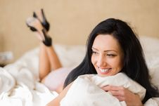 Woman In Lingerie Lying On The Bed In Her Bedroom Royalty Free Stock Photos