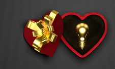 Golden Light Bulb In Heart-shaped Box Royalty Free Stock Images