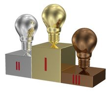 Golden, Silver And Bronze Light Bulbs On Metallic Pedestal Stock Images
