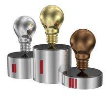 Free Golden, Silver And Bronze Light Bulbs On Cylindrical Pedestal Royalty Free Stock Image - 36488286