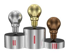 Free Golden, Silver And Bronze Light Bulbs On Cylindrical Pedestal. Front View Stock Photos - 36488313
