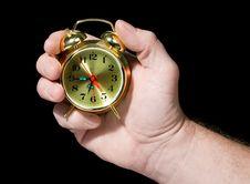 Alarm Clock In A Hand Royalty Free Stock Photos