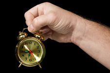 Alarm Clock In A Hand 2 Stock Image