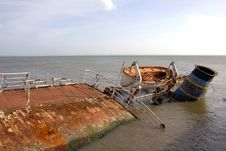 Rusted Shipwreck In The Coast Stock Image