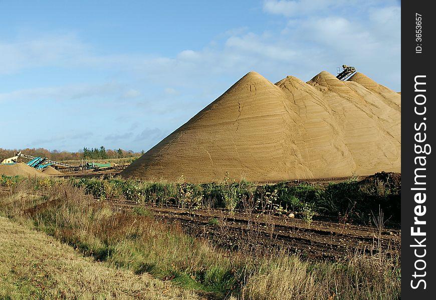 Enormous gravel heaps at a pit