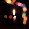 Free Flame Of A Candle On A Dark Background With Colored Bokeh Stock Image - 36509961