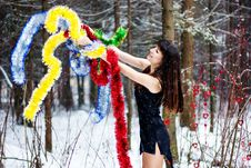 Free Beautiful Woman With Bright Tinsel In Winter Forest Stock Photos - 36500103
