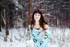 Beautiful Woman Under Warm Cute Wrap In Cold Snow Forest Stock Photography