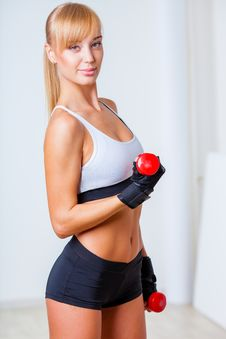Woman Holding Red Dumbbells Royalty Free Stock Photo
