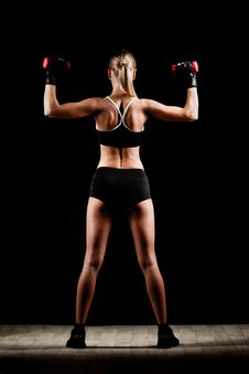 Free Woman Holding Red Dumbbells Stock Photos - 36517193