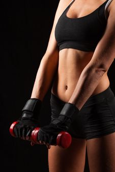 Woman Holding Red Dumbbells Stock Photography