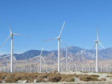 Free Desert Windmills With Mountains Royalty Free Stock Photo - 36518695