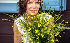 Free Woman Looking Happy Behind Flowers Stock Photos - 36522993