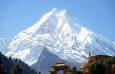 Snow Peak, And The Buddhist Monastery On Its Background Stock Images