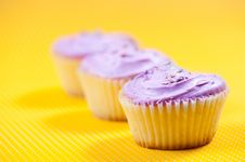 Free Muffin With Vanilla Filling Against Yellow Background Royalty Free Stock Photos - 36526758