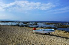 Free Fishing Boat Standing On The Sand Of A Beach Stock Photos - 36537473