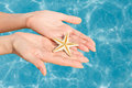 Free Woman Holding Starfish In A Hands Stock Image - 36547041