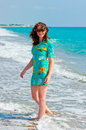 Free Charming Brunette In A Turquoise Dress On The Beach Stock Photos - 36547953