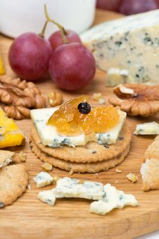 Crackers With Blue Cheese And Apple Jam, Nuts And Grapes Stock Photos