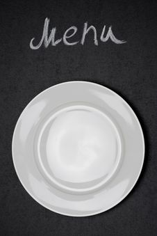 Free Menu Title Written With Chalk And White Plate On Black Board Stock Photography - 36543022