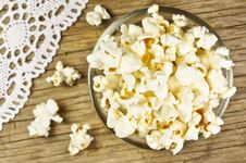 Popcorn In Bowl On Wooden Table Royalty Free Stock Photos