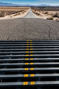 Free Cattle Grate Crossing In A Road To Mountains Stock Images - 36571654