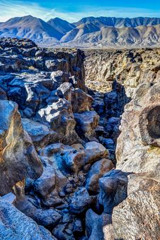 Free Fossil Falls Boulders Of Lava In A Valley Stock Photos - 36571673