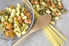 Free Uncooked Pasta With Wooden Spoon Royalty Free Stock Image - 36581676
