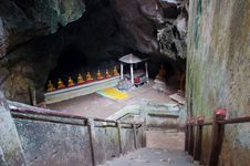 The Entrance Of The Ancient Cave With Golden Buddha In Thailand Stock Image