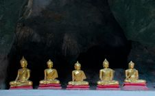 Five Sitting Golden Buddha In The Cave In Thailand Stock Photography