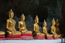 Six Sitting Golden Buddha In The Cave In Thailand Stock Photography