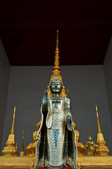 The Metal Standing Buddha With Golden Pagoda In The Temple In Th Royalty Free Stock Photos