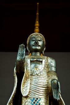 The Metal Standing Buddha With Golden Pagoda In The Temple In Th Royalty Free Stock Image