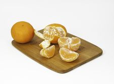 Free Clementine Oranges On A Bamboo Cutting Board Royalty Free Stock Images - 36591399