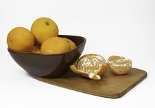 Free Clementine Oranges, Brown Bowl, And Bamboo Cutting Board Stock Photo - 36596850