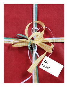 Free Gift With Bows And An Empty Tag With Room For Your Text Stock Photos - 36598633