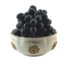 Grapes In Ceramic Bow. Stock Photography