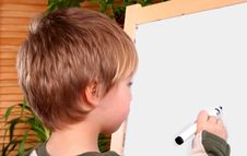 Boy Drawing Stock Image