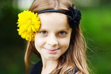 Girl With Flowers In Her Hair Royalty Free Stock Photo